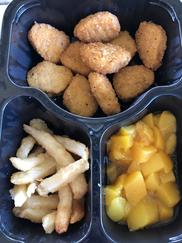 Chicken nuggets, fries and fruit